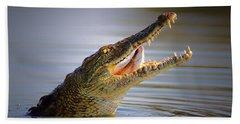 Nile Crocodile Swollowing Fish Hand Towel by Johan Swanepoel