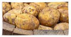 Freshly Harvested Potatoes In A Wooden Bucket Hand Towel by Tom Gowanlock