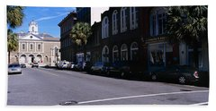 Buildings On Both Sides Of A Road Hand Towel by Panoramic Images