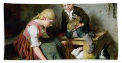 Feeding The Rabbits Hand Towel by Felix Schlesinger