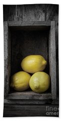 Lemons Still Life Hand Towel by Edward Fielding