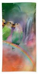 Love On A Rainbow Hand Towel by Carol Cavalaris