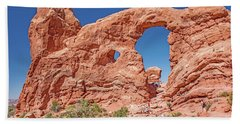 Hand Towel featuring the photograph Tourists On Sandstone Arch Formation, Arches National Park by A Gurmankin