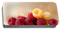 Ripe Red And Golden Raspberry Fruits In Pile  Portable Battery Charger by Arletta Cwalina