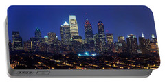 Buildings Lit Up At Night In A City Portable Battery Charger by Panoramic Images