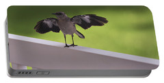 A Little Visitor Northern Mockingbird Portable Battery Charger by Terry DeLuco