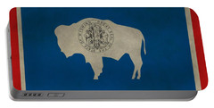 Aged Wyoming State Flag Portable Battery Charger by Dan Sproul