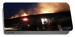 Portable Battery Charger featuring the photograph An Engine Crew Works At Night On White Draw Fire by Bill Gabbert