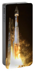Portable Battery Charger featuring the photograph Atlas V Rocket Taking Off by Science Source