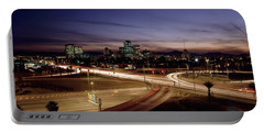 Buildings In A City Lit Up At Dusk, 7th Portable Battery Charger by Panoramic Images