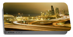 Buildings Lit Up At Night, Seattle Portable Battery Charger by Panoramic Images