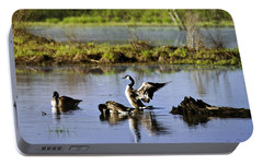 Canada Goose Dancing On Lake Portable Battery Charger by Christina Rollo