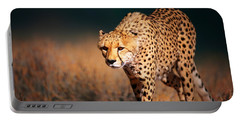 Cheetah Approaching From The Front Portable Battery Charger by Johan Swanepoel
