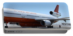 Portable Battery Charger featuring the photograph Dc-10 Air Tanker At Rapid City by Bill Gabbert