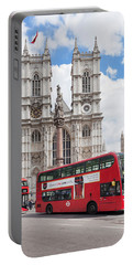 Double-decker Buses Passing Portable Battery Charger by Panoramic Images