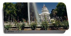 Fountain In A Garden In Front Portable Battery Charger by Panoramic Images