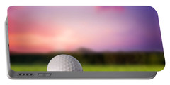 Golf Ball On Tee At Sunset Portable Battery Charger by Michal Bednarek