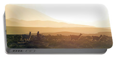 Herd Of Llamas Lama Glama In A Desert Portable Battery Charger by Panoramic Images
