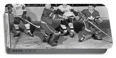 Hockey Goalie Chin Stops Puck Portable Battery Charger by Underwood Archives