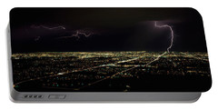 Lightning In The Sky Over A City Portable Battery Charger by Panoramic Images