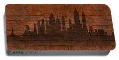 New York City Skyline Silhouette Distressed On Worn Peeling Wood Portable Battery Charger by Design Turnpike