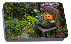 Pumpkin In Basket On Chair Portable Battery Charger by Garry Gay