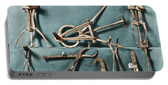 Portable Battery Charger featuring the photograph Roman Surgical Instruments, 1st Century by Science Source