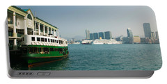 Star Ferry On A Pier With Buildings Portable Battery Charger by Panoramic Images