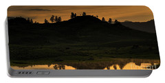 Portable Battery Charger featuring the photograph Sunrise Behind A Yellowstone Ridge by Bill Gabbert