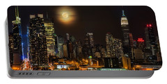 Super Moon Over Nyc Portable Battery Charger by Susan Candelario