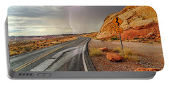 Uncertainty - Lightning Striking During A Storm In The Valley Of Fire State Park In Nevada. Portable Battery Charger by Jamie Pham