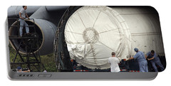 Portable Battery Charger featuring the photograph Unloading A Titan Ivb Rocket by Science Source