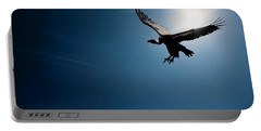 Vulture Flying In Front Of The Sun Portable Battery Charger by Johan Swanepoel
