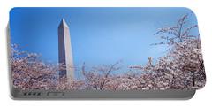 Washington Monument Behind Cherry Portable Battery Charger by Panoramic Images
