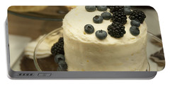 White Frosted Cake With Berries Portable Battery Charger by Juli Scalzi