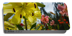 Yellow Whopper Lily 1 Portable Battery Charger by Jacqueline Athmann