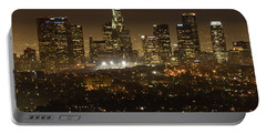 Los Angeles Skyline At Night Portable Battery Charger by Bob Christopher