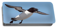 Razorbill In Flight Portable Battery Charger by Bruce J Robinson
