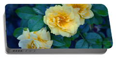 Portable Battery Charger featuring the photograph Yellow Roses by Rodney Campbell