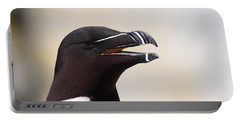 Razorbill Portrait Portable Battery Charger by Bruce J Robinson