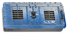 Old Blue Door Portable Battery Charger by Tom Gowanlock