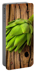 Artichoke On Old Wooden Board Portable Battery Charger by Garry Gay