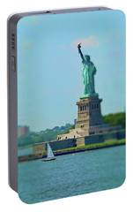 Big Statue, Little Boat Portable Battery Charger by Sandy Taylor