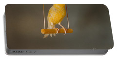 Canary On Swing Portable Battery Charger by William J. Jahoda