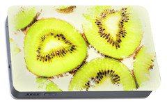 Close Up Of Kiwi Slices Portable Battery Charger by Jorgo Photography - Wall Art Gallery
