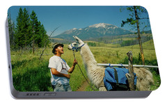 Man Teasing A Llama Portable Battery Charger by Jerry Voss