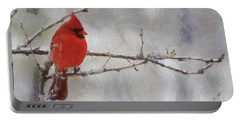 Red Bird Of Winter Portable Battery Charger by Jeff Kolker
