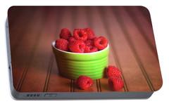 Red Raspberries Still Life Portable Battery Charger by Tom Mc Nemar