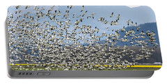 Snow Geese Exodus Portable Battery Charger by Mike Dawson