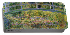 The Waterlily Pond With The Japanese Bridge Portable Battery Charger by Claude Monet